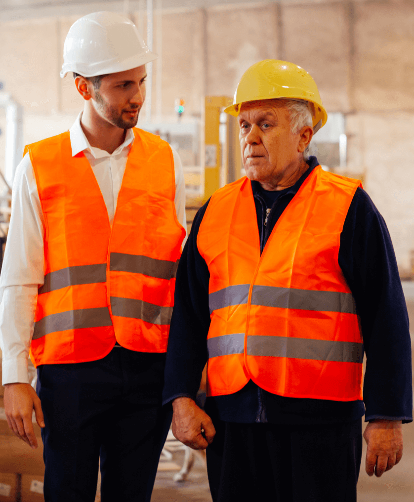 One young and one older blue-collar worker on the job