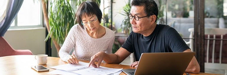 older couple searching for resources