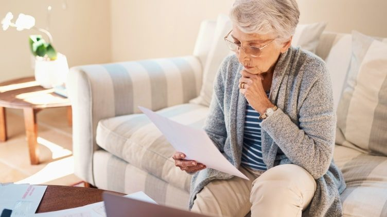 Older woman studying documents