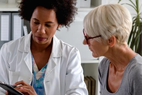 Female doctor with elderly patient