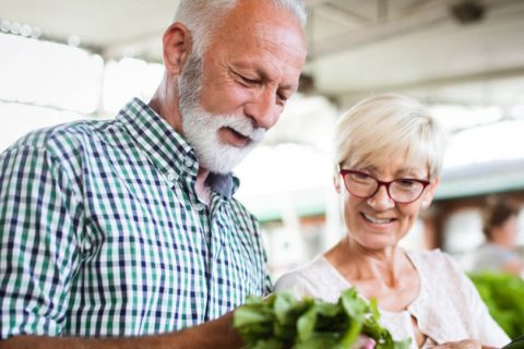Elderly couple shopping at grocery store