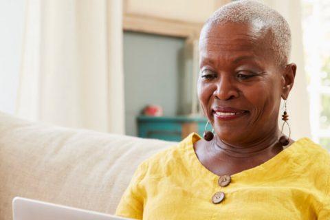 Elderly woman on her laptop