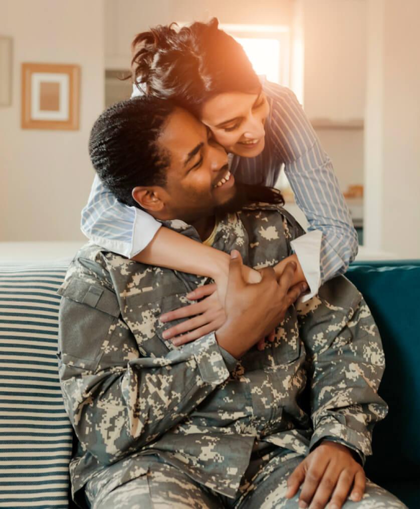 Woman hugging her veteran spouse