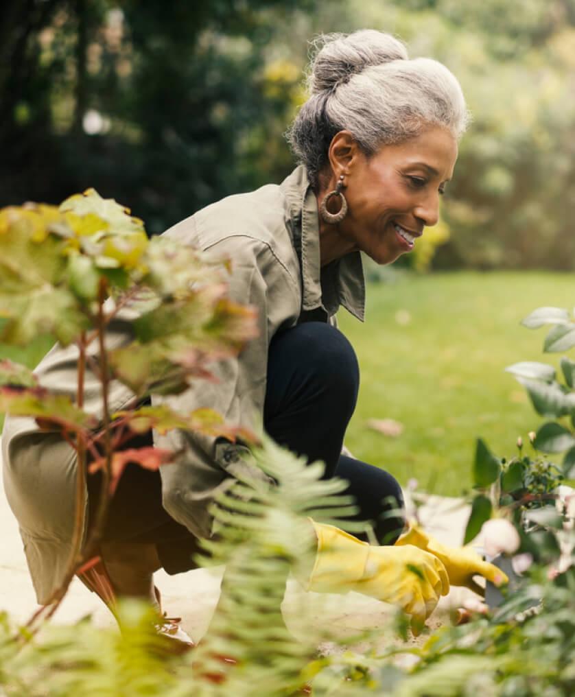 Elderly woman tending to her garden