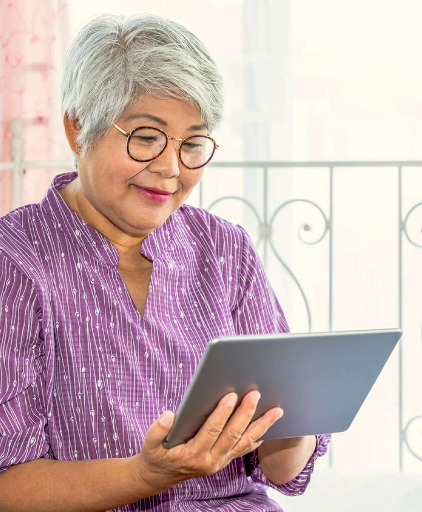 Woman signing up for Medicare on her iPad
