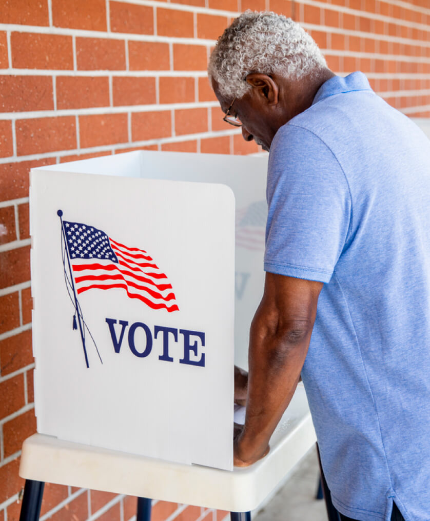 Elderly man at the voting booth