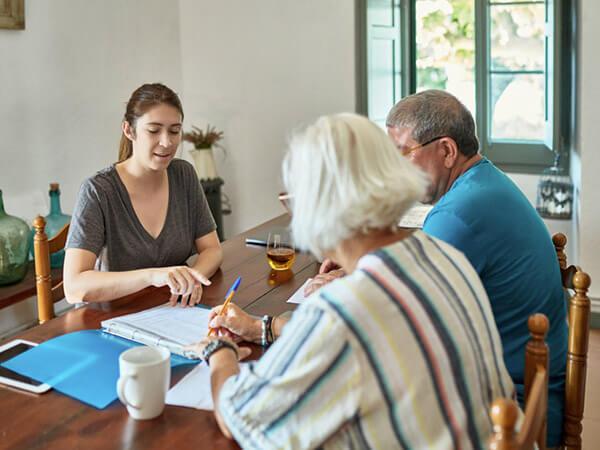 Medicare advisor helping older couple