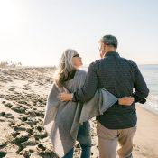 Older couple walking along the beach