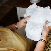 Older woman holding an adult diaper