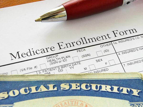 Medicare open enrollment form and social security card