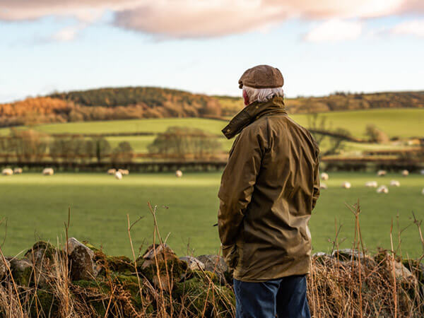Older man standing alone in a field