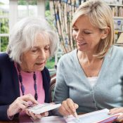 Younger woman helping older woman with finances