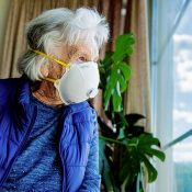 Older woman looking out of the window