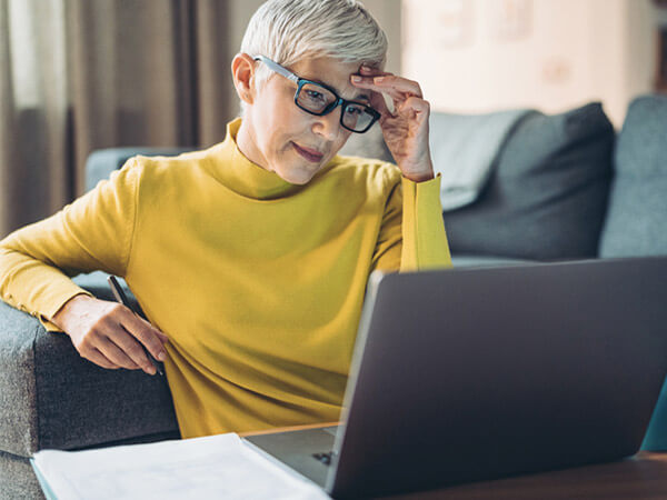 Older woman struggling to use a website