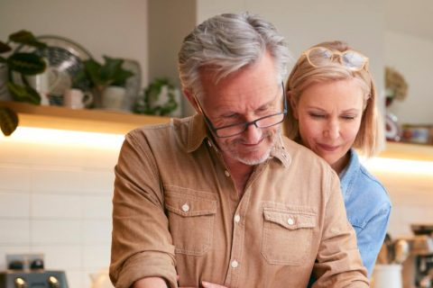 Older couple signing life insurance contract