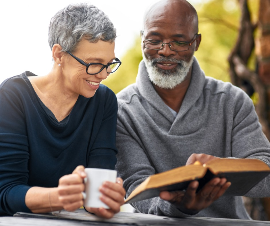 older couple with glasses reading book
