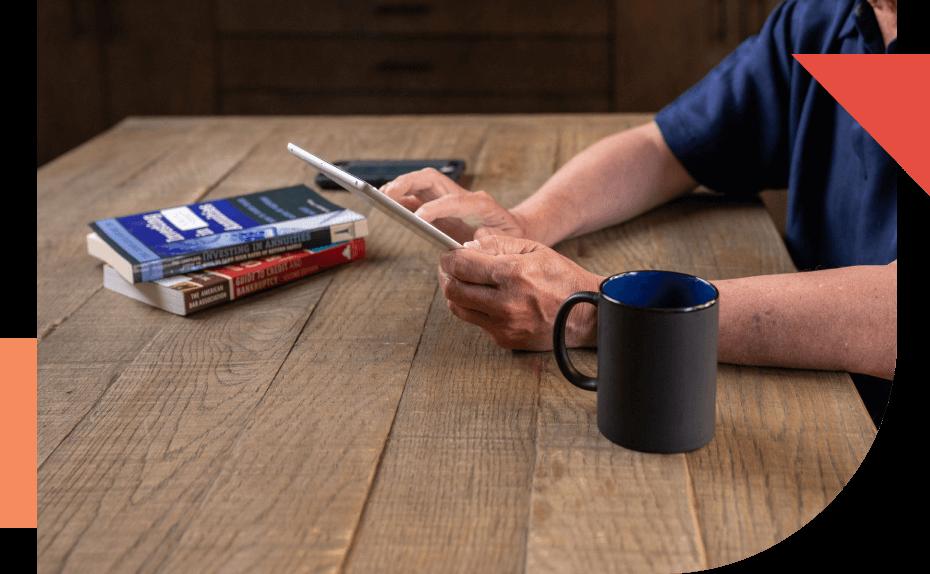 Man on ipad while having coffee