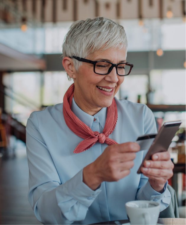 Woman using smartphone and credit card