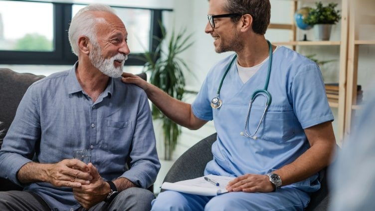 Older man and doctor talking