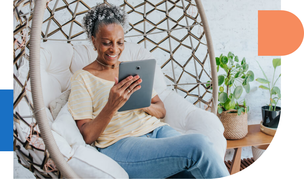 Woman using ipad while sitting in chair